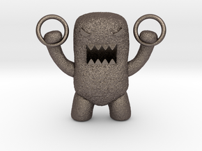 Domo Monster doing exercises with rings in Stainless Steel