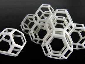 Space filling truncated octahedra in White Strong & Flexible