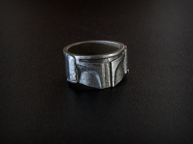 Bounty Hunter Helmet Ring 3d printed Photo of the ring in Frosted Detail, painted with silver acrylic paint. The ring does not arrive painted.