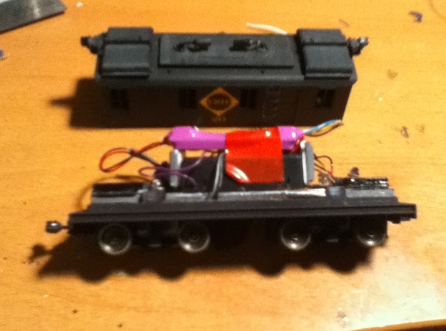HO Scale Boxcab Locomotive Frame 3d printed This shows a typical installation with two Stanton drives, a TSU-1000 Tsunami decoder and lead weights over the trucks. The frame and trucks now sit at prototypically correct height and the coupler is perfectly in gauge.