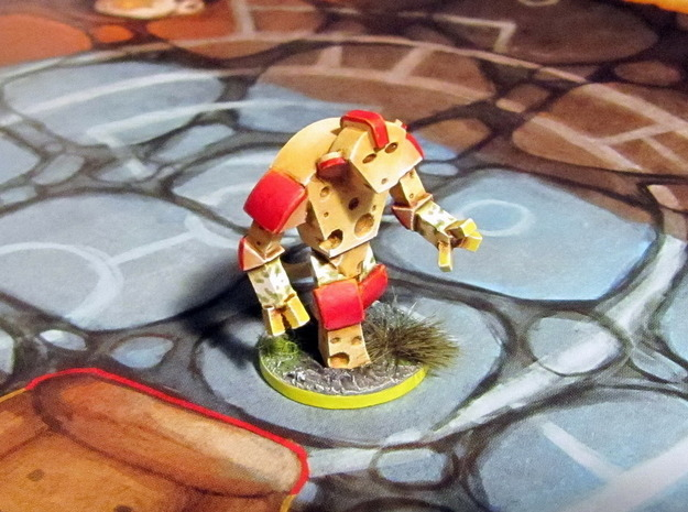 Cheese Golem 3d printed Model hand-painted & based (front), after filing and sanding (game board with flagstones copyright Plaid Hat Games).