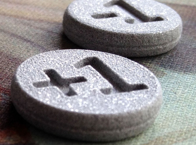 Plus/Minus Tokens (Batch of 5) 3d printed Close-up of the Alumide tokens showing the fine detail in the embossed numbers.