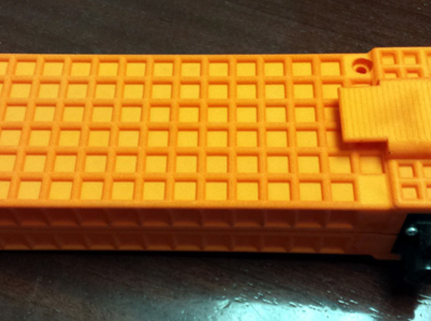 Surveying external battery LiPo Case 3d printed Dyed orange with Geodimeter plates in