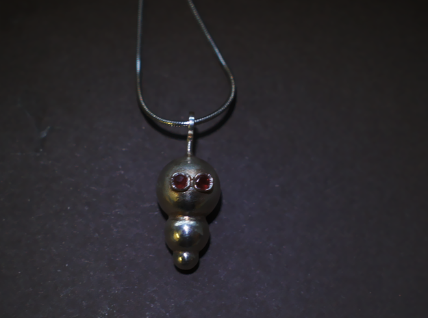 My little Robot 3d printed robot pendant on this picture in silver with two garnets