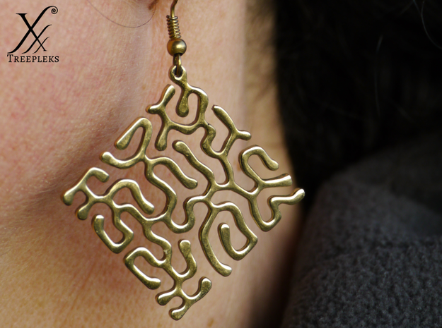 Reacting Earrings 3d printed Printed in polished brass.