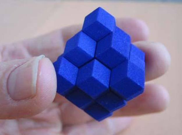 Octahedron with child 3d printed Assembled puzzle in hand.