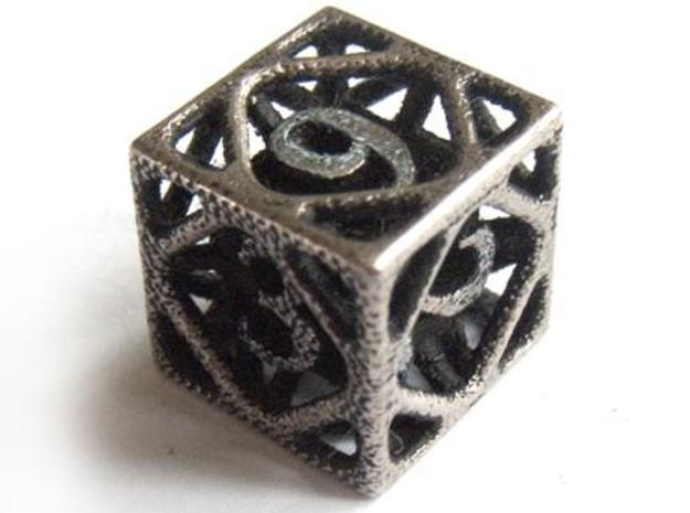 Cage Die6 3d printed In stainless steel and inked