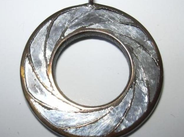 Swirl Pendant 3d printed With silver clay inserts
