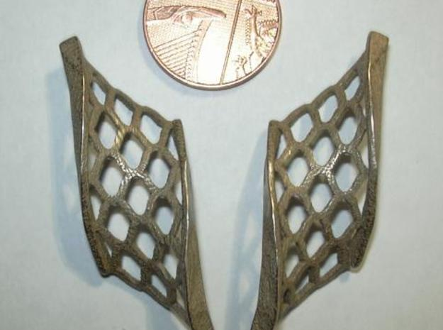 Twisted lattice girder earrings 3d printed Photo - as shipped (without penny shown for size)