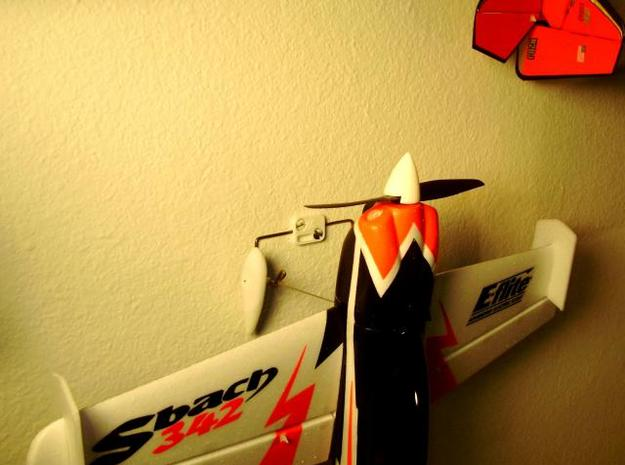 Sm Plane Hanger Lite 3d printed Sbach hung from the mount on the wall.