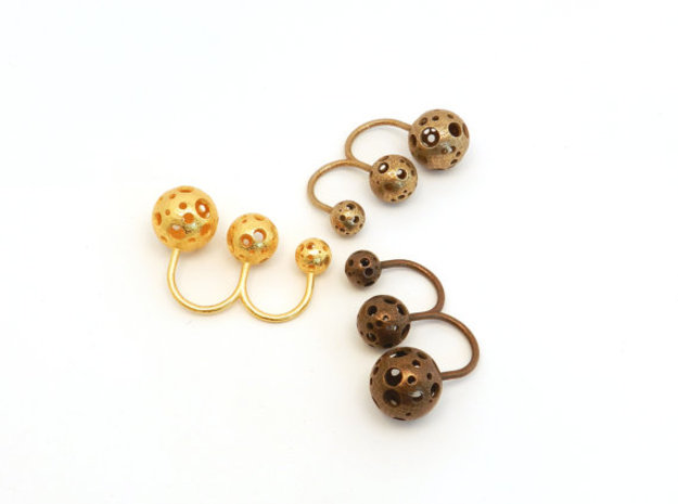 Triple Moonball Ring 3d printed polished gold steel, stainless steel, polished bronze steel