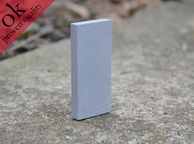 monolith 1*4*9 3d printed in polished alumide, placed outside to attract little animals