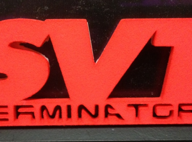 Actual emblem printed in Coral Red strong & flexible polished