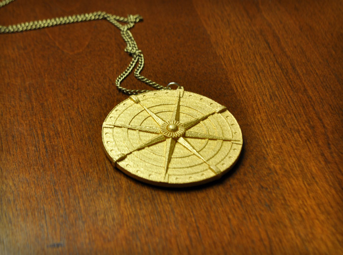 Gold plated matte finish compass medallion