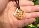 Grid Pendant small in Polished Gold Steel