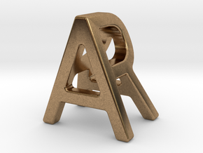 AR RA - Two way letter pendant in Natural Brass