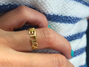 The Helvetica ring  (Size K, 50). in Natural Brass