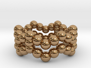 Ring Sphere 2 waved in Polished Brass