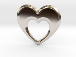 Heart within a heart pendant  in Rhodium Plated Brass