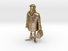 Man holding a suitcase in Polished Gold Steel