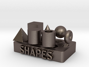 Collection of Primitive Shapes in Polished Bronzed Silver Steel