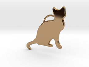 Cat Sitting in Polished Brass