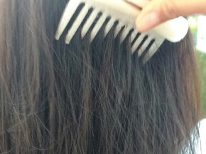 Ergonomic Comb in White Natural Versatile Plastic