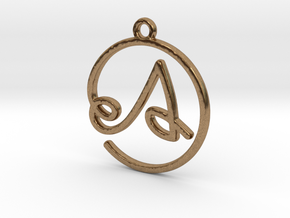 A Script Monogram Pendant in Raw Brass