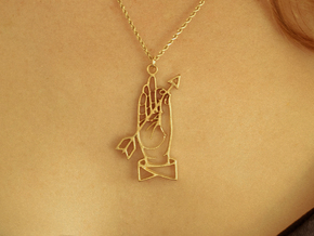 Hand and arrow in Raw Brass