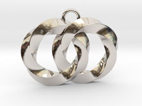 Twisting Planets Pendant  in Rhodium Plated Brass