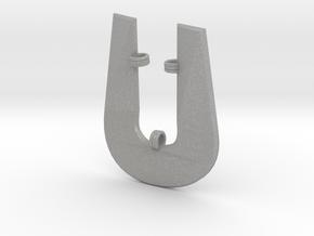 Distorted letter U in Aluminum