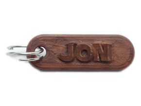 JON Personalized keychain embossed letters in White Natural Versatile Plastic
