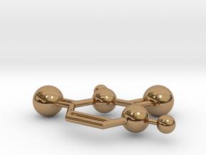Uracil in Polished Brass