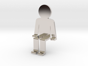 Person sitting in Rhodium Plated Brass