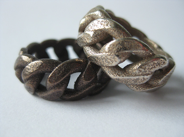 Chained Ring of Honor 3d printed - Chained Ring of Honor in Antique Bronze Glossy (left) and Stainless Steel (right) -