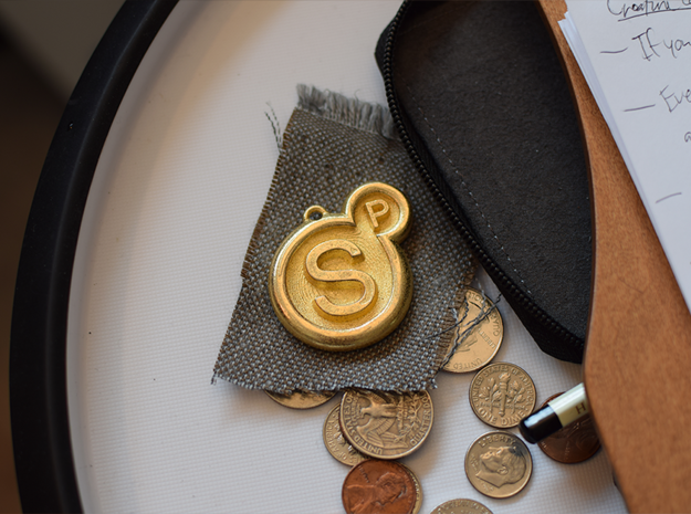 Surreal Products Logo Keychain in Polished Gold Steel