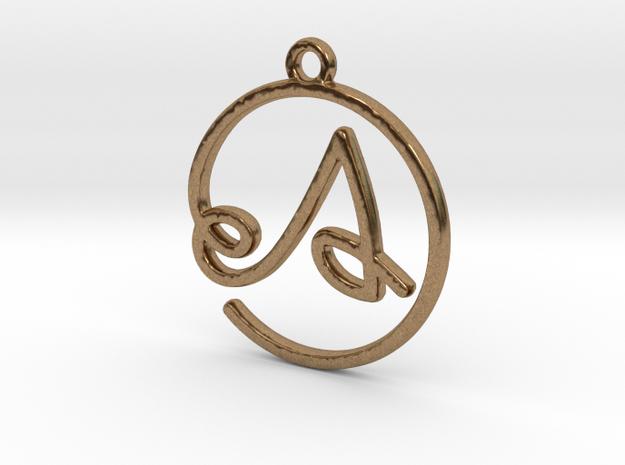 A Script Monogram Pendant in Raw Brass