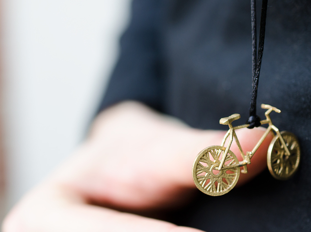 Bicycle brass pendant with moving wheels! in Interlocking Raw Brass