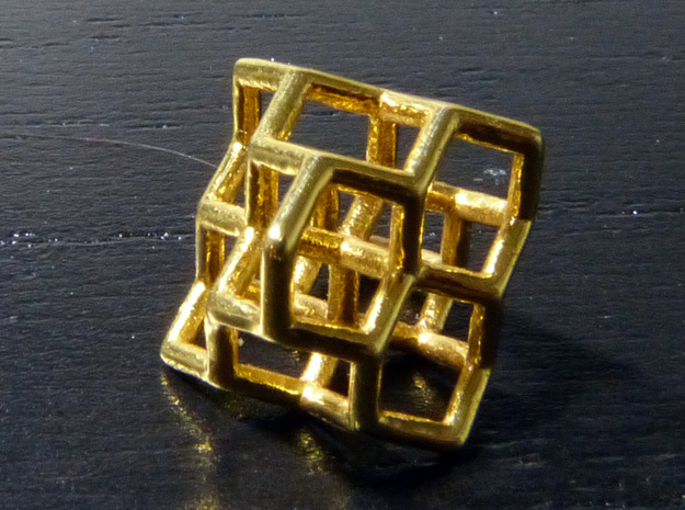 Diamond structure (tiny) 3d printed Printed in gold plated brass.