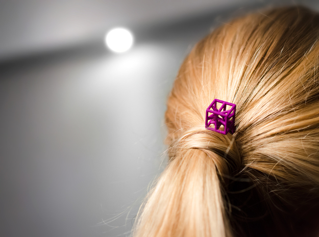 Hairpin with stylized cube.