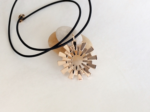 Pendant - 3D Printed Sun in Fine Metals 3d printed Sun pendant in polished bronze.