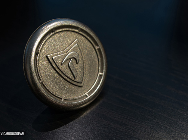 Prince Horn Button 3d printed The raw print in Stainless Steel.