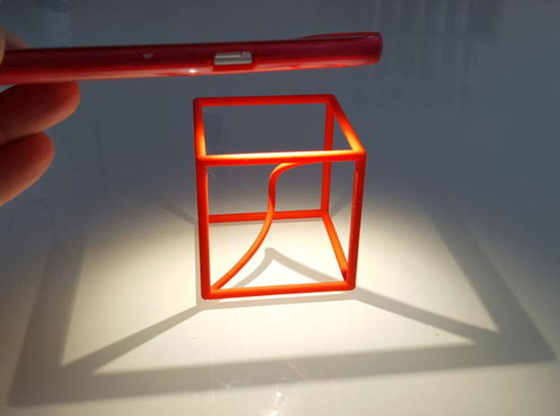 A space curve in a cube in Red Strong & Flexible Polished