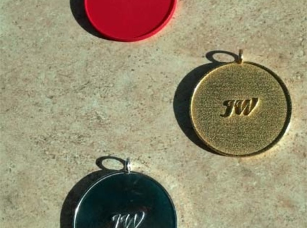 Navajo Water Sign Medallion 3d printed Pure silver (bottom), gold plated steel (center), red nylon (top)