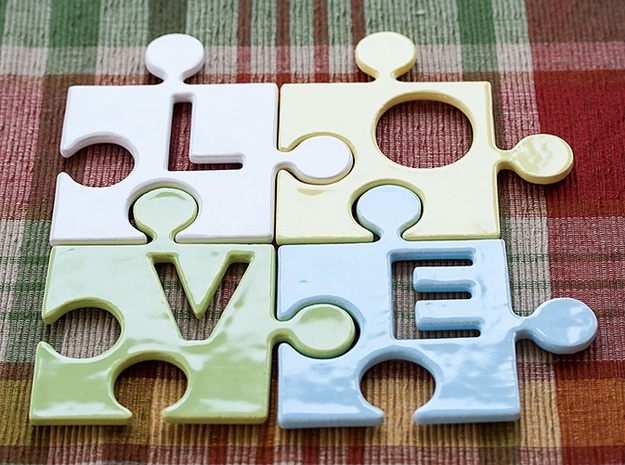 """Puzzle Piece E - """"Love-letters"""" 3d printed 4 puzzle pieces combined to write the word """"love""""."""