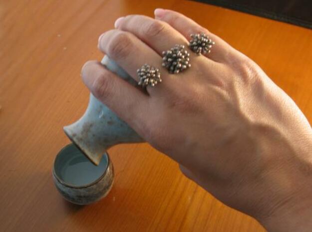 Triple Starburst Ring 3d printed steel on hand