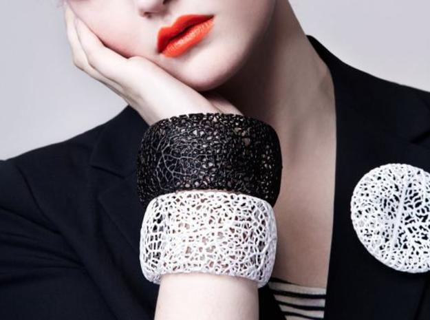 Rhizome Cuff (sz L) 3d printed in black and white on model