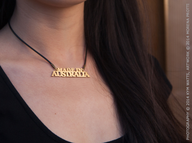 Made in AUSTRALIA Pendant 3d printed Raw Brass. The pendant is sold alone, it comes in a velvet pouch.