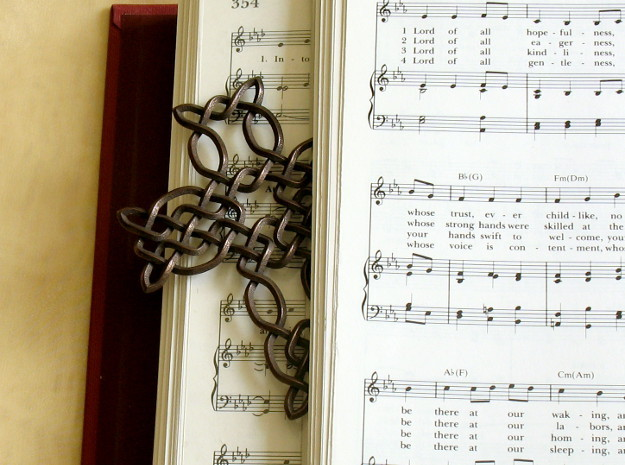 Celtic knot cross 3d printed Printed in polished bronze-plated steel, with hymnal for scale!
