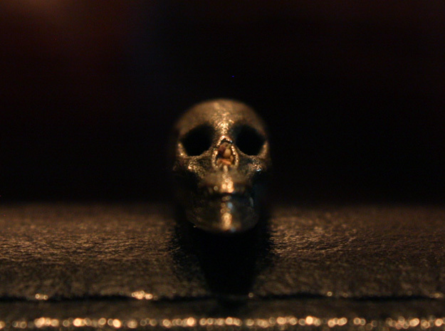 Hidden Anamorphic Skull Optical Illusion in Polished Bronzed Silver Steel